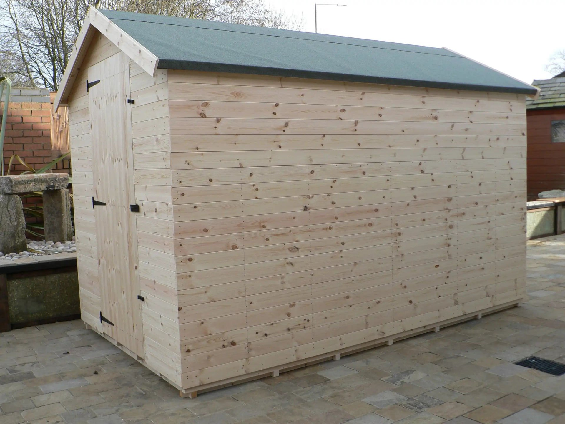 Sheds Manchester - 10' x 6' Apex Shed With No Windows And The Door Hinged On The Left
