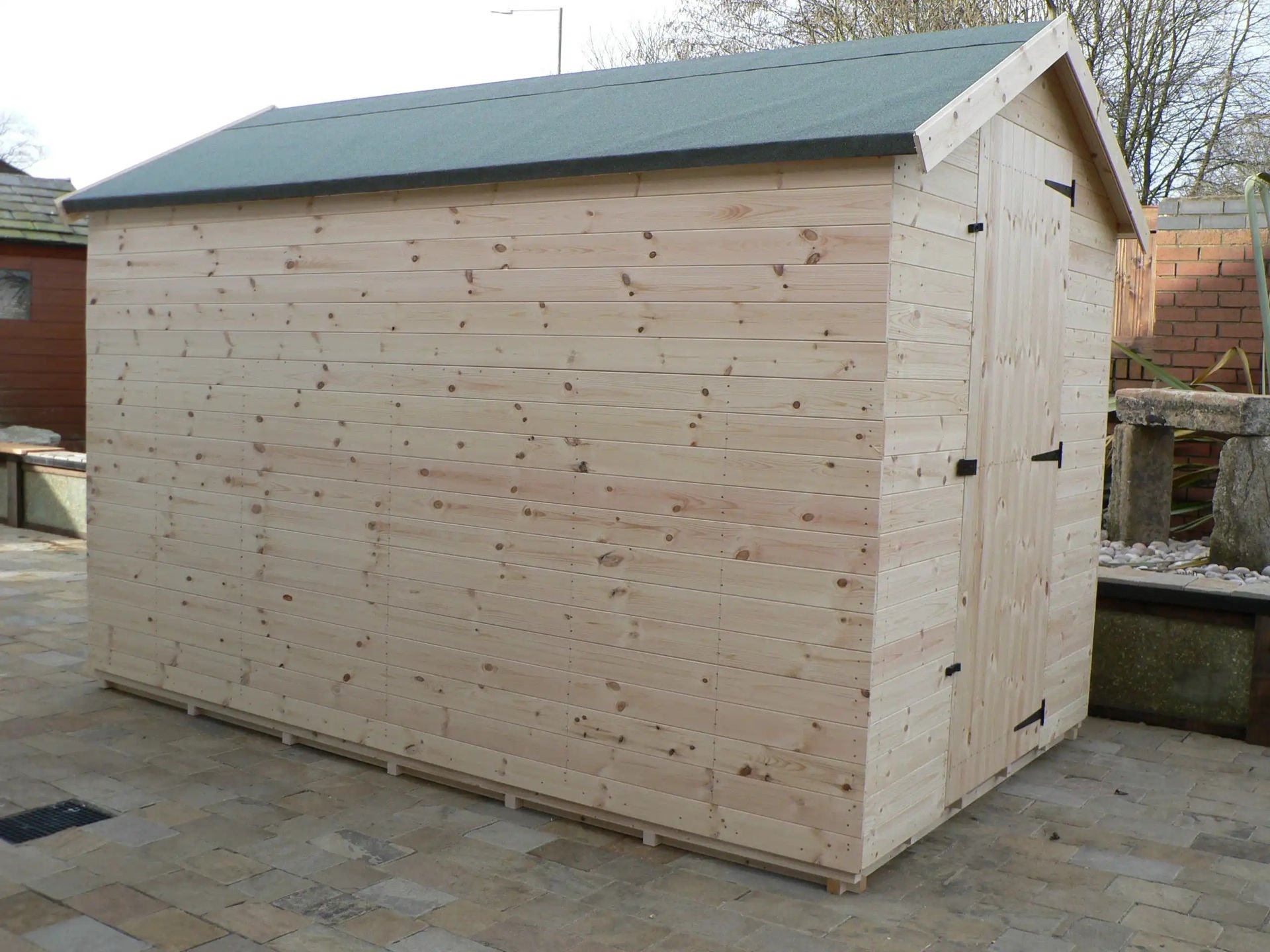 Sheds Manchester - 10' x 6' Apex Shed With No Windows And The Door Hinged On The Right