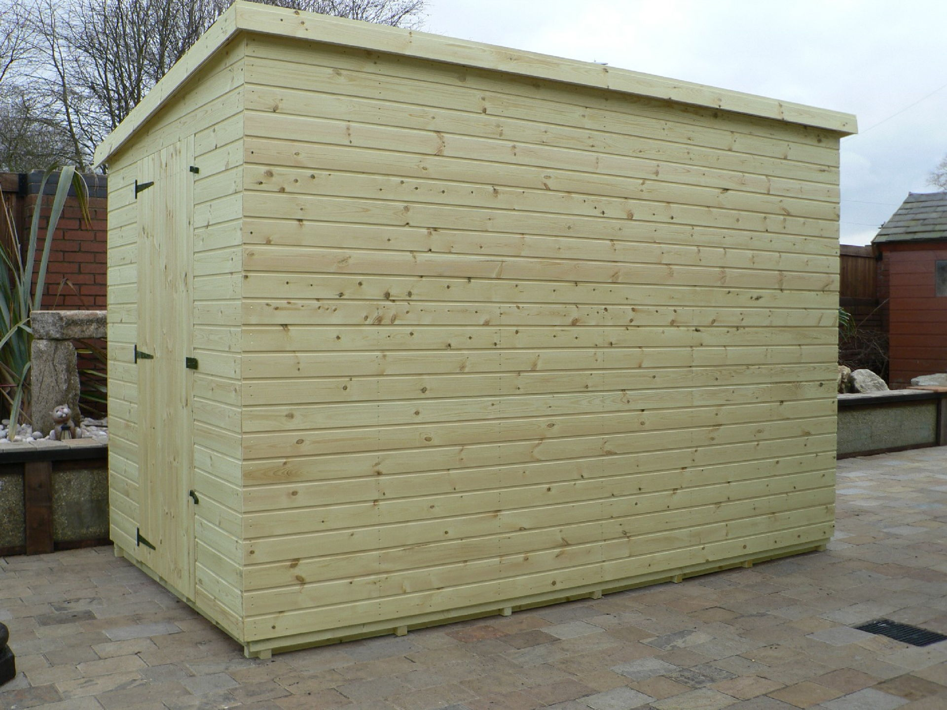 Sheds Manchester - Pressure Treated 10' x 6' Pent Shed . Door On The Left Gable End Panel. No Windows