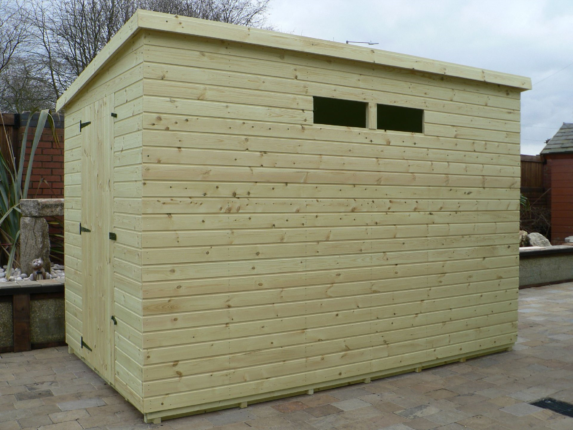 Sheds Manchester - Pressure Treated 10' x 6' Pent Shed . Door On The Left Gable End Panel. Security Windows
