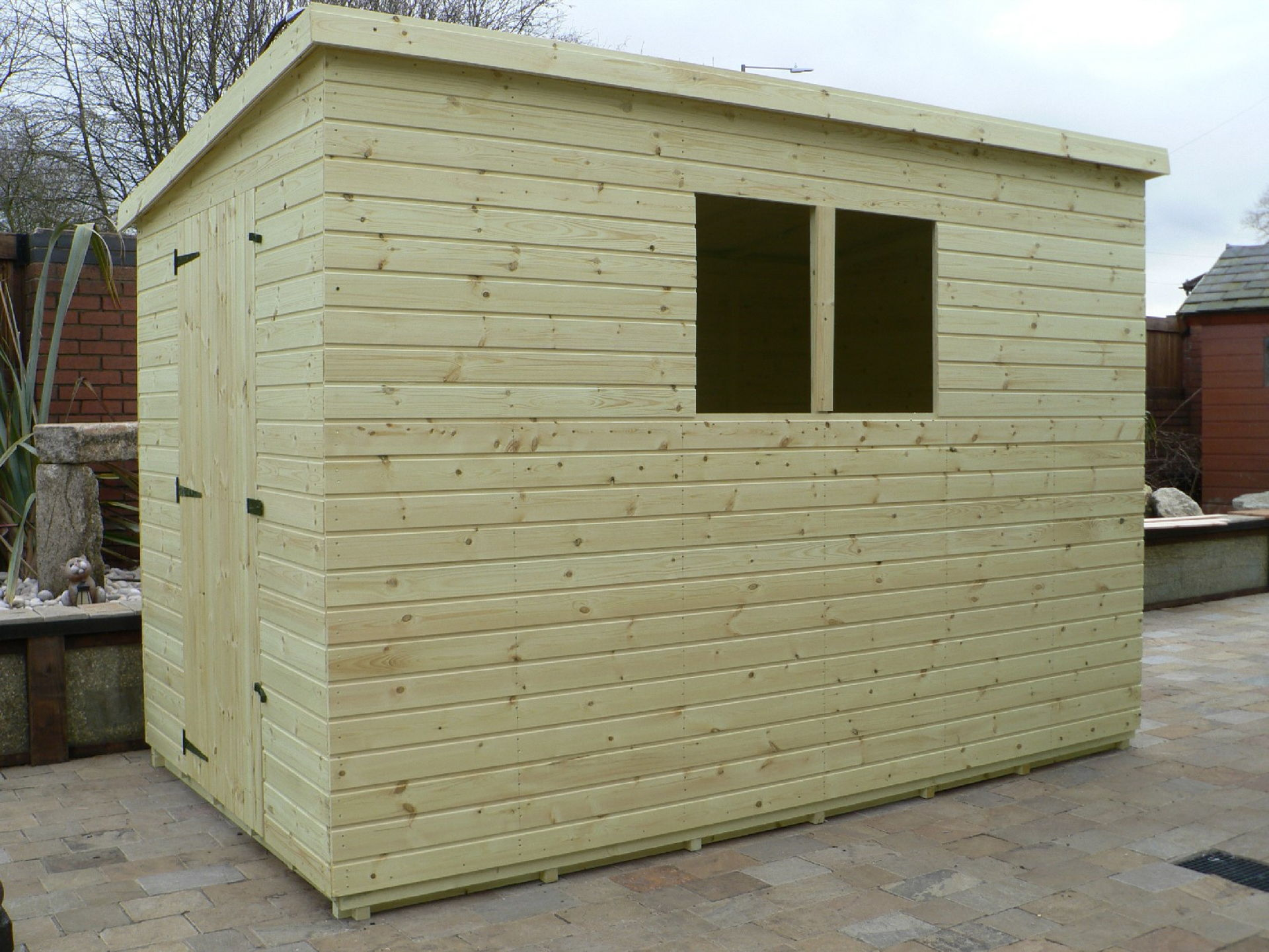 Sheds Manchester - Pressure Treated 10' x 6' Pent Shed . Door On The Left Gable End Panel