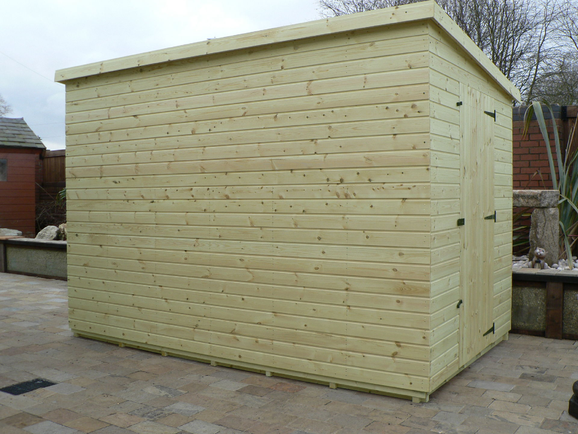 Pressure Treated 10' x 6' Pent Shed . Door On The Right Gable End Panel. No Windows