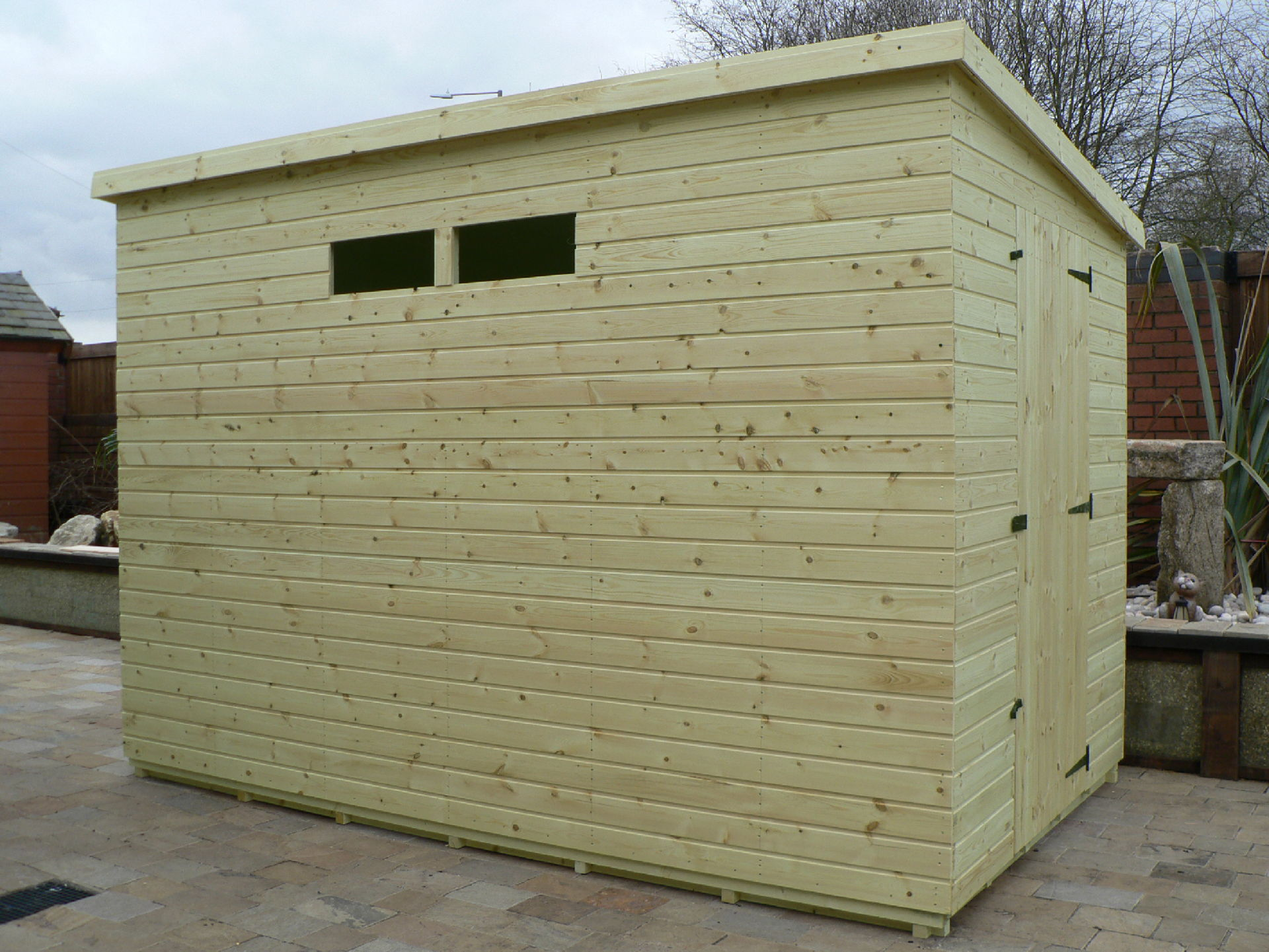 Sheds Manchester - Pressure Treated 10' x 6' Pent Shed . Door On The Right Gable End Panel. Security Windows