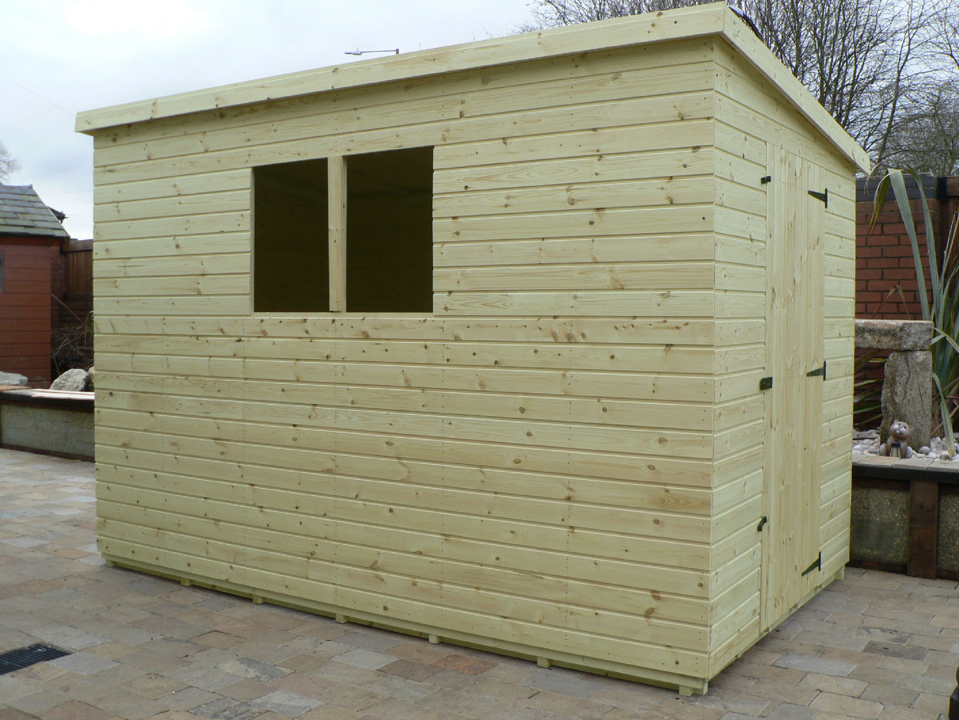 Sheds Manchester - Pressure Treated 10' x 6' Pent Shed . Door On The Right Gable End Panel