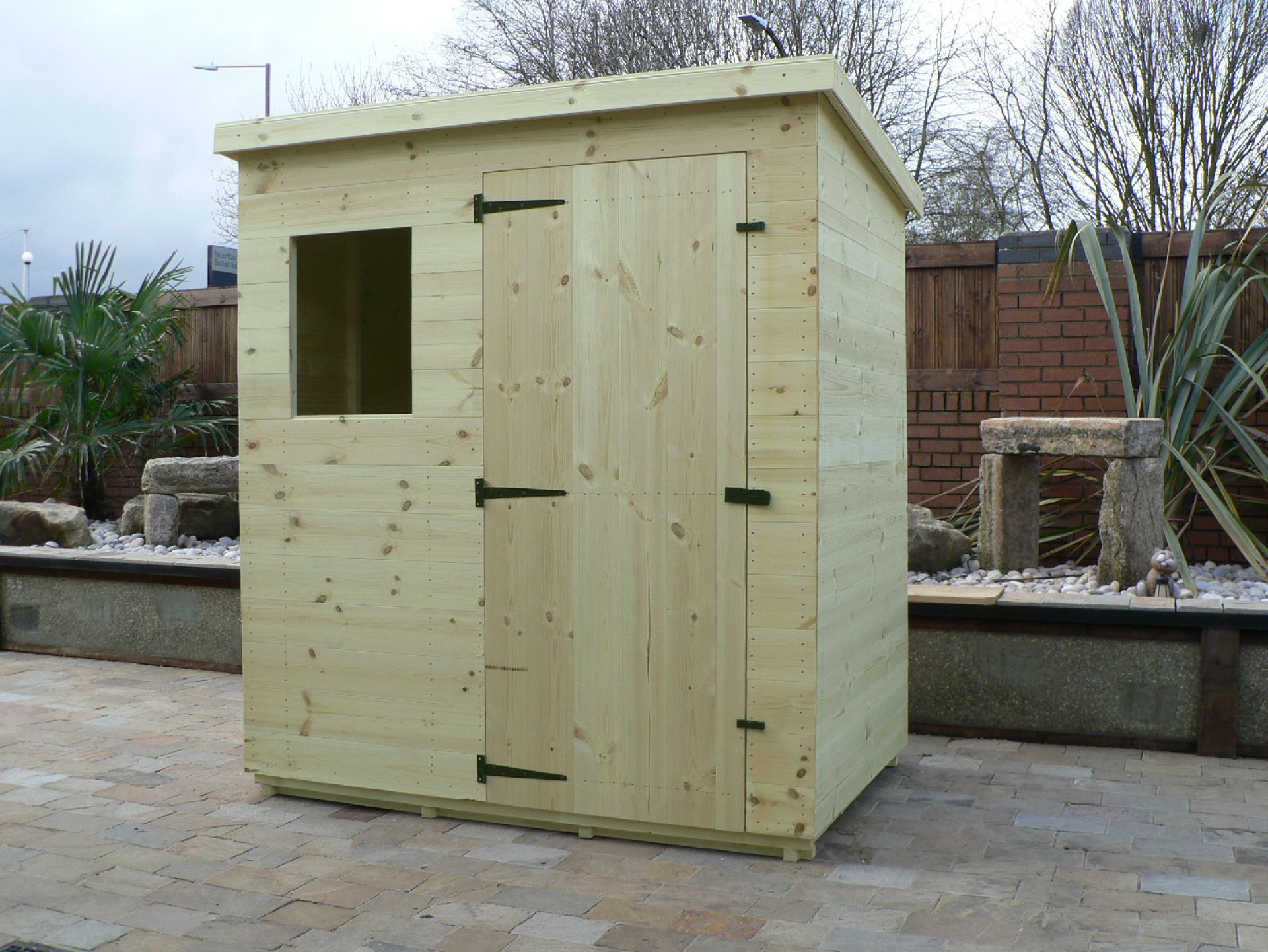 Sheds Manchester - Pressure Treated 6' x 4' Pent Shed . Door On The Front Panel