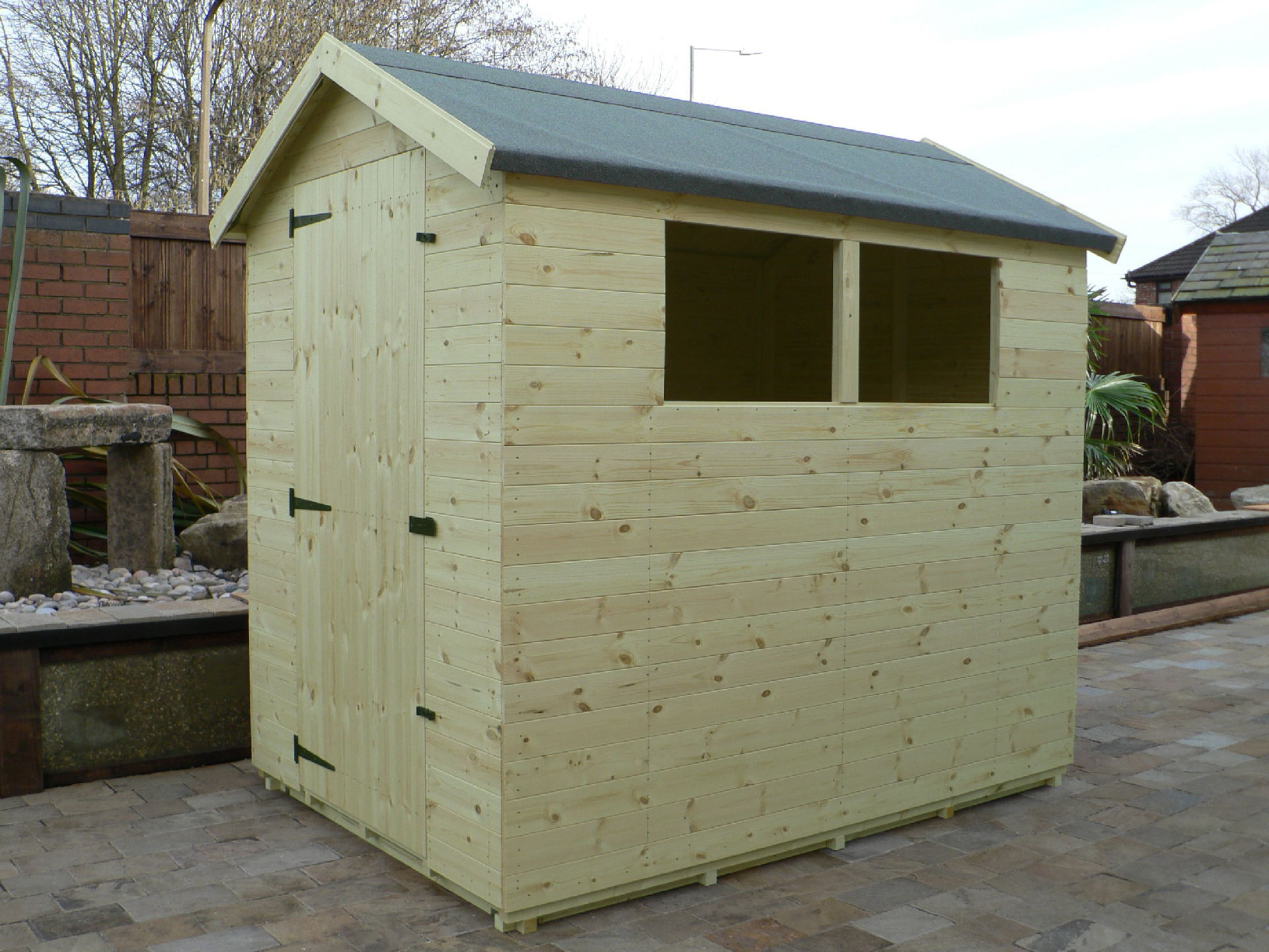 Sheds Manchester - Pressure Treated 7' x 5' Apex Shed . Door On The Left Gable End