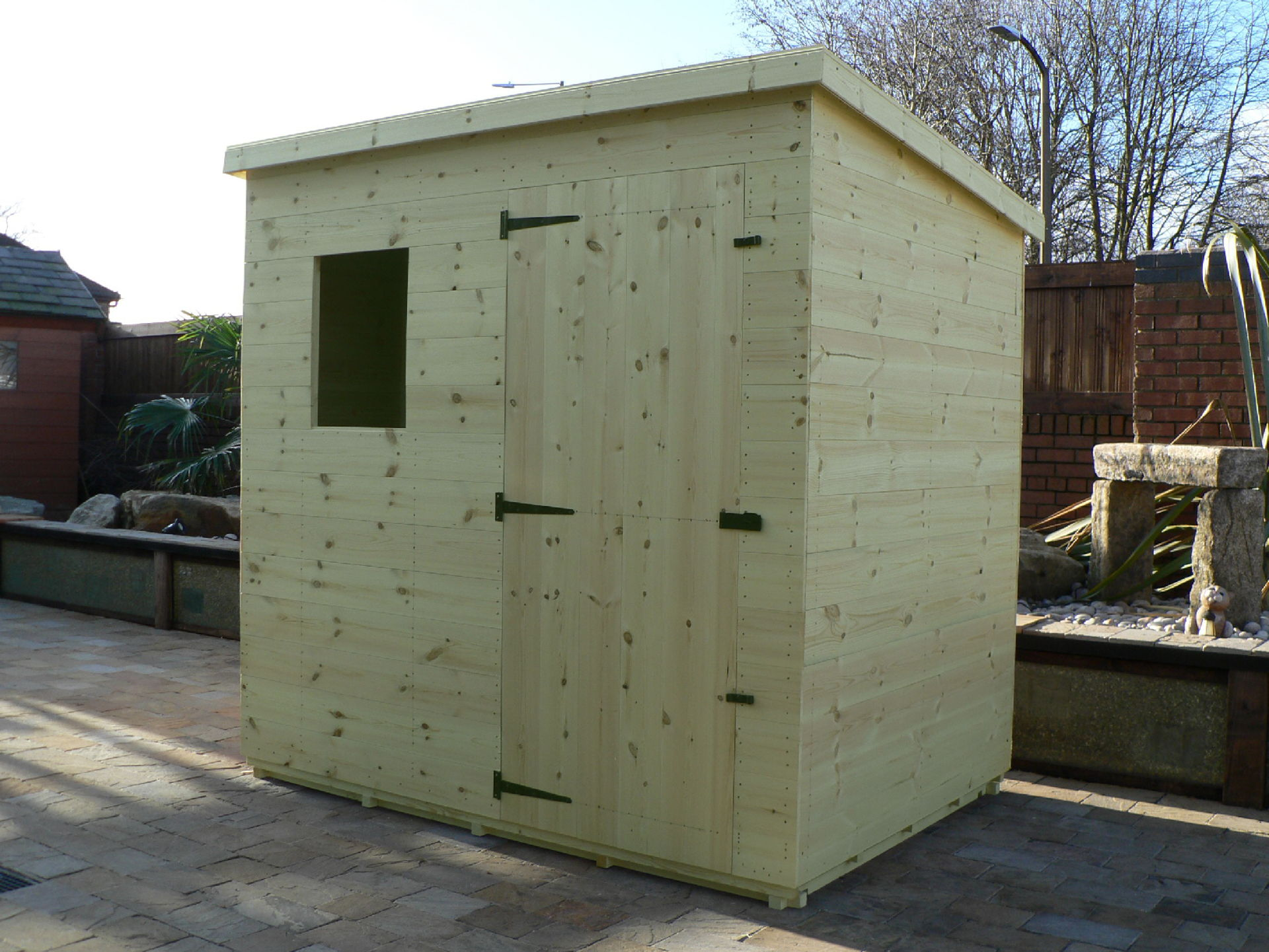 Sheds Manchester - Pressure Treated 7' x 5' Pent Shed . Door On The Front Panel