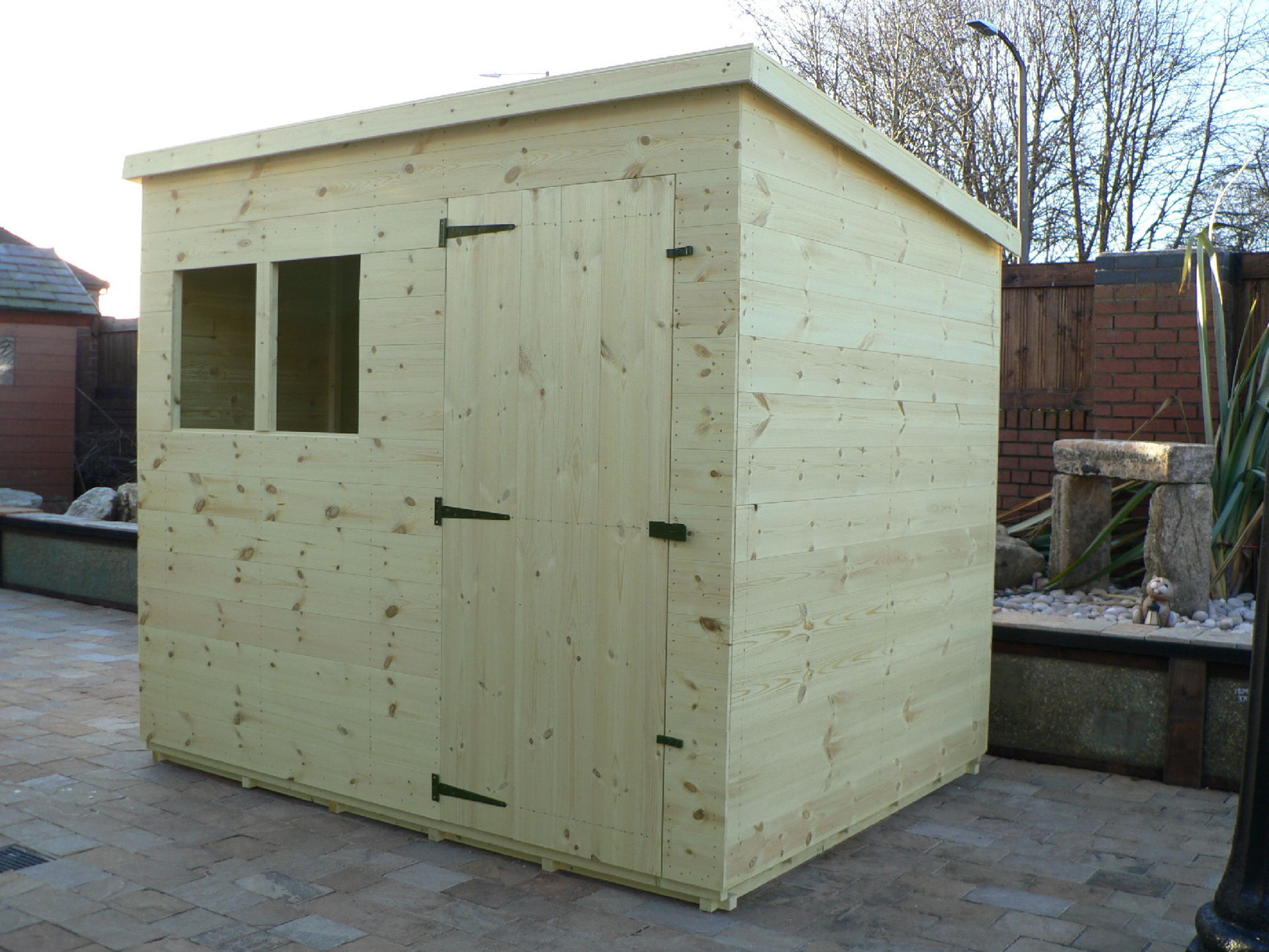 Sheds Manchester - Pressure Treated 8' x 6' Pent Shed . Door On The Front Panel